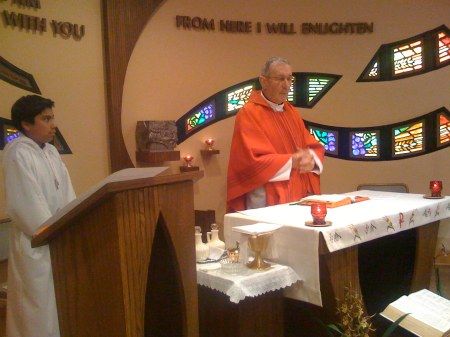 Father Mario, SSP, of the Sociedad San Pablo, east Los Angeles, celebrates the Mass of Pentecost