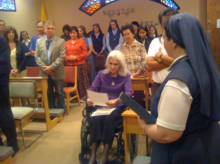Carol Ann makes her Promises as a Pauline Cooperator; Sr Madonna Janet and the community witnesses
